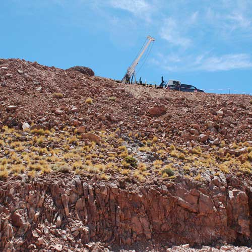 Main Breccia outcrop with drill rig in background